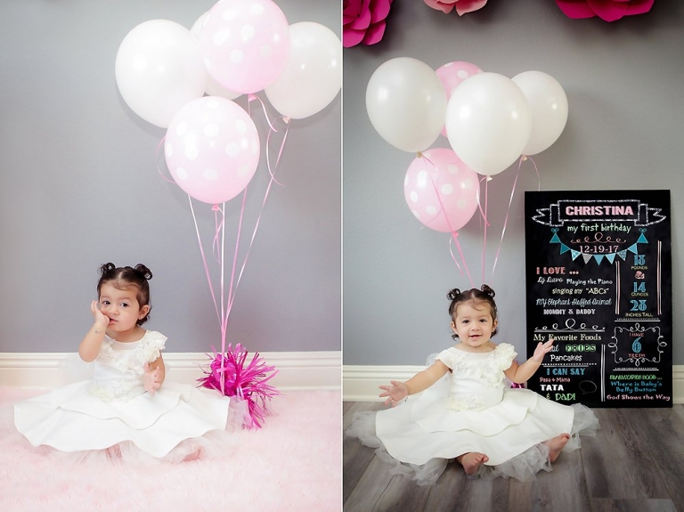 Christina turns one and celebrates with her Cake Smash. Posing with balloons & a hardboard with her favorite things.